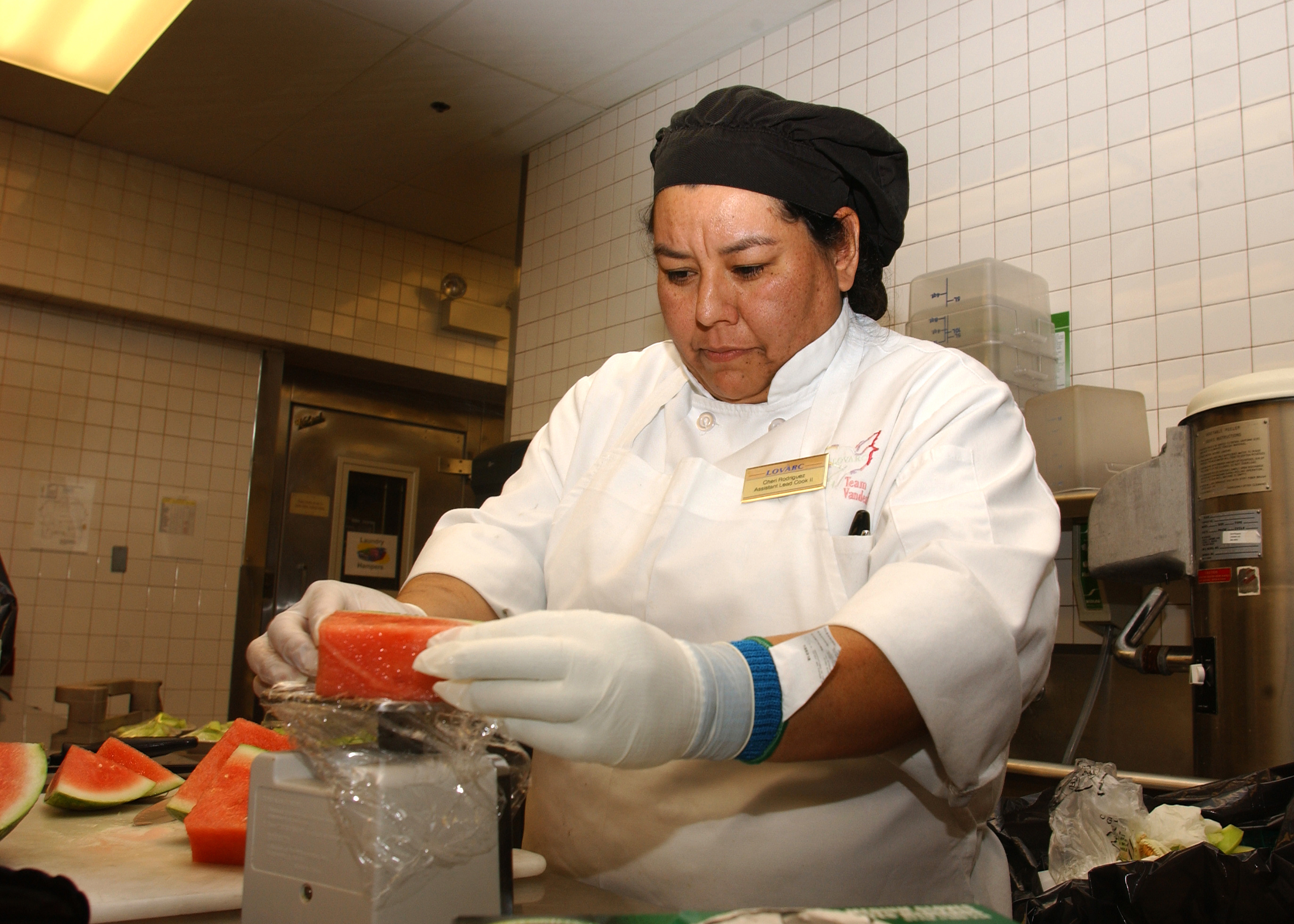 of 2 cheri rodriguez a 30th services division lead cook weighs watermelon at breakers dining facility on vandenberg afb