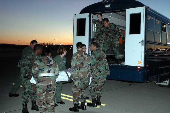 The 60th Aeromedical Staging Flight works as a team to get military patients on board the ambulance bus as comfortably as possible. More than 2,500 U.S. military members wounded in Afghanistan and Iraq have passed through Travis to receive aid from the 60th Aeromedical Staging Flight at David Grant USAF Medical Center. (U.S. Air Force photo by Staff Sgt. Matt McGovern/60th Air Mobility Wing Public Affairs)