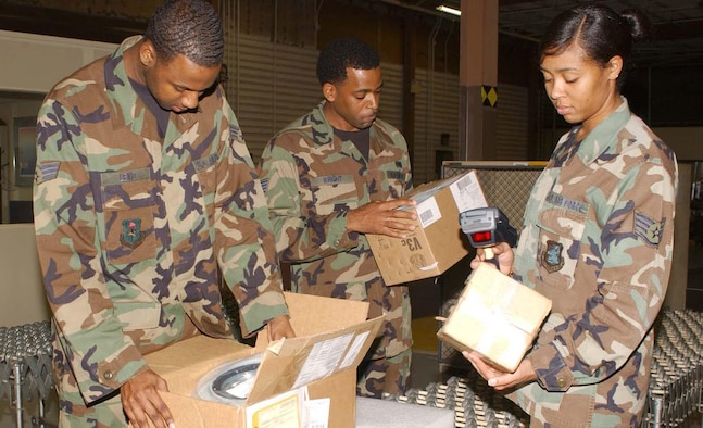From left, Senior Airman Charles Lewis and Staff Sgts. Tamorrace Wright and Toyshaline Young, 81st Supply Squadron, check in mission-capable parts inside their warehouse. The 81st Supply Squadron made Keesler logistical history Nov. 27 when all 18 of the 403rd Wing's C-130J aircraft and other reportable systems attached to them, remained fully mission capable for five consecutive days. (U.S. Air Force photo by Kemberly Groue)