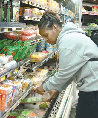 Staff Sgt. Sandra Denson, 23rd Aeromedical-Dental Squadron dental technician, selects a vegetable tray at a local grocery store recently. Moody dieticians recommend to eat from vegetable, fruit or deli trays at get-togethers in order to help with weight maintenance and combat weight gain during the holidays. It is also recommended that people stay away from serving tables to help avoid unconscious nibbling and over-eating. (U.S. Air Force photo by Senior Airman Leticia Hopkins)
