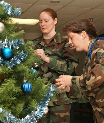 Staff Sgts. Sandra Homer, left, 81st Contracting Squadron, and Tina Nadbalek, 332nd Training Squadron, decorate a Christmas tree at the Biloxi Veterans Affairs Medical Center Sunday. The visit was a part of Operation Not Forgotten, a monthly volunteer effort by Magnolia Chapter 652 of the Air Force Sergeants Association to visit patients at the center to show appreciation for their military service. For more information about AFSA or to volunteer for the program, visit http://www.afsa652.org. (U.S. Air Force photo by Adam Bond)