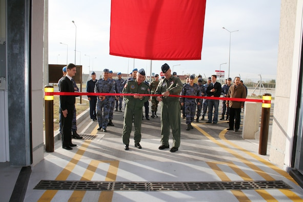 "Col. Murrell ""Tip"" Stinnette, 39th Air Base Wing commander, right, and Brig. Gen. M. Yilmaz Erdogan, left, 10th Tanker Command commander, cut the ribbon at the large vehicle inspection station here Dec. 5. The buiding is a joint effort between the 10th Tanker Command and the 39th Air Base Wing. (Courtesy of 10th Tanker Command)"