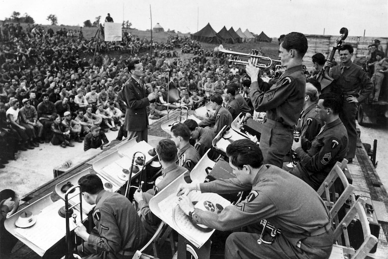 Maj. Glenn Miller conducts the band during an open air concert. (U.S. Air Force photo)