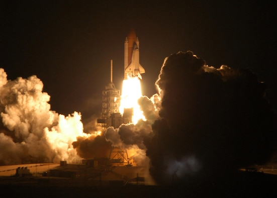 Space Shuttle Discovery leaps toward the sky Dec. 9 from Launch Pad 39B at Kennedy Space Center, Fla.  This is Discovery's 33rd mission and the first night launch since 2003.  The shuttle is scheduled to return Dec. 21.  (NASA photo/Jim Grossmann)