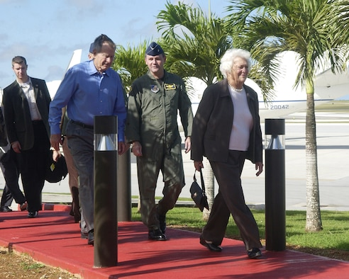 ANDERSEN AIR FORCE BASE, Guam – Brig. Gen. Douglas H. Owens, 36th Wing commander, greets former President George H.W. Bush and former first lady Barbara Bush Dec. 10 at Andersen on a brief stopover en route to Thailand. During their brief visit here, the former President toured the base heritage museum and took time with Mrs. Bush to thank Airmen for their continued service to our country. (U.S. Air Force photo by Airman 1st Class Daniel Owen) (Released)