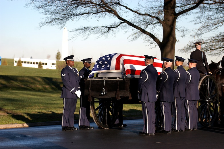 Air Force Honor Guardsmen transfer the casket carrying Maj. Troy Gilbert from the caisson to the grave site during a full honors funeral Dec. 11 at Arlington National Cemetery.  Major Gilbert was the pilot of an Air Force F-16 Fighting Falcon engaged in support of coalition ground combat operations that crashed approximately 20 miles northwest of Baghdad Nov. 27. (U.S. Air Force photo/Maj. Francisco G. Hamm)