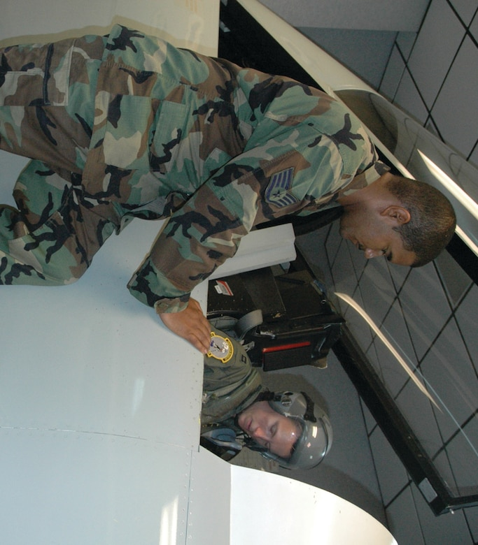 TYNDALL AIR FORCE BASE, Fla. --  Staff Sgt. Jose Rivera, Life Support NCO in charge, helps Capt. Charles Kistler understand F-15 egress procedures. Sergeant Rivera is with the 325th Operations Support Squadron, and Captain Kistler is with the 2nd Fighter Squadron. (U.S. Air Force photo by Chrissy Cuttita)