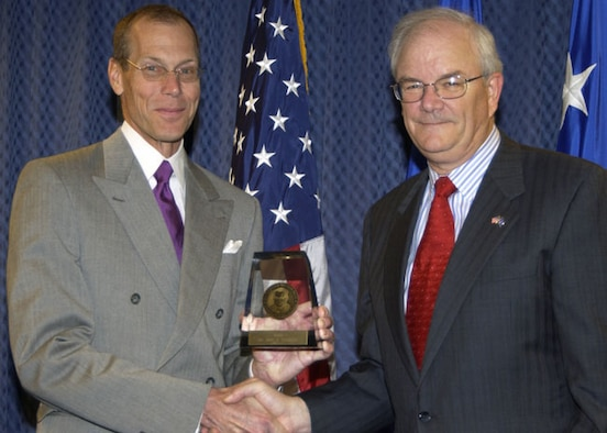 Dr. John Caldwell accepts the 2005 Harold Brown Award from Secretary of the Air Force Michael Wynne. (Air Force photo)