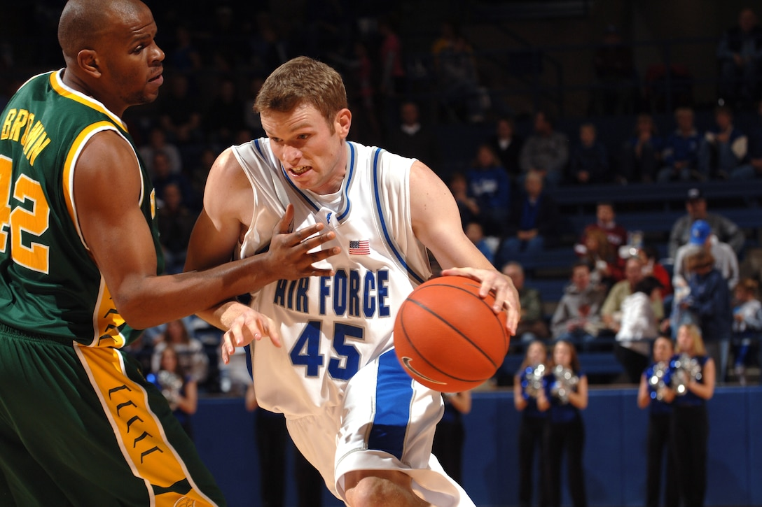 Falcon center Nick Welch drives past Norfolk State's Calvin Brown Dec. 13 at Clune Arena. Welch scored eight points and grabbed five rebounds in Air Force's 70-47 win over the Spartans. (U.S. Air Force photo/Dave Armer)