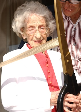 """Hortense """"Tonsie"""" Gaudé, 103, of Biloxi cuts the reopening ribbon Monday at Gaudé Lanes which is named after her late son, 1st Lt. Robert Gaudé. The facilty has been closed for repairs since May. (U.S. Air Force photo by Kemberly Groue)"""