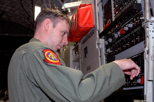 Tech. Sgt, Corey Clewley, 21st Airlift Squadron loadmaster, checks equipment on a C-17 prior to takeoff. While performing a special mission in Southwest Asia, he helped suppress a brake fire onboard a Romanian C-130, saving the lives of the C-130 crew and preventing the total loss of the aircraft.