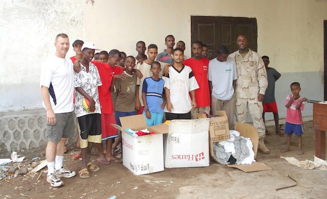 Chief Master Sgt. William Welch, deployed from 336th Training Group, and RP2 Greg Bennett, chaplain assistant, work with an all boys-orphanage in Djibouti, Africa. Chief Welch coordinated a drive to send clothing and supplies from Fairchild to the orphanage.