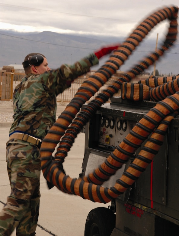 Staff Sgt. Christpoher Croley, 9th Aircraft Maintenance Unit, puts away tubing from a stray voltage check during the Weapons Load Crew of the Quarter competition Dec. 8. Sergeant Croley is the load crew chief of the winning team. (U.S. Air Force photo by Airman Jamal Sutter)