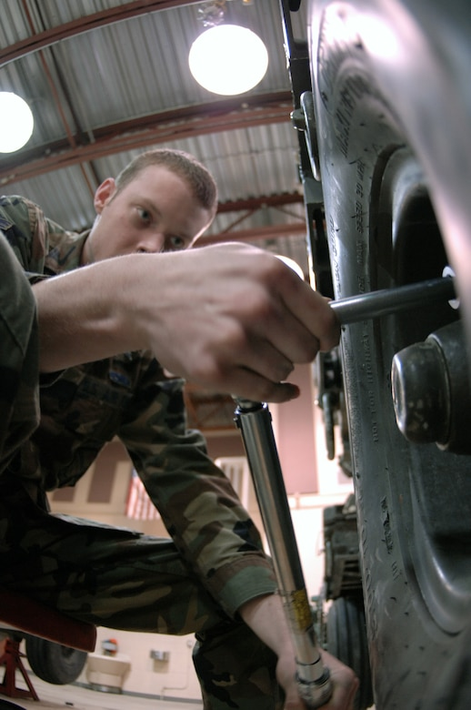 EIELSON AIR FORCE BASE, Alaska -- Airman First Class Daryl Mitchell, 354th Maintenance Squadron, 354th Fighter Wing, checks a tire during a 365 inspection on an MHU-141/M Munitions Handling Trailer here on 13 December. The inspection is a yearly operational and maintenance check on the trailer which can be configured to carry different munition types. (U.S. Air Force Photo by Staff Sgt Joshua Strang)