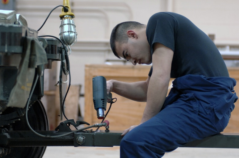 EIELSON AIR FORCE BASE, Alaska -- Airman Jaime Valle, 354th Maintenance Squadron, 354th Fighter Wing, works on the tounge assembly during a 365 inspection on an MHU-141/M Munitions Handling Trailer here on 13 December. The inspection is a yearly operational and maintenance check on the trailer which can be configured to carry different munition types. (U.S. Air Force Photo by Staff Sgt Joshua Strang)