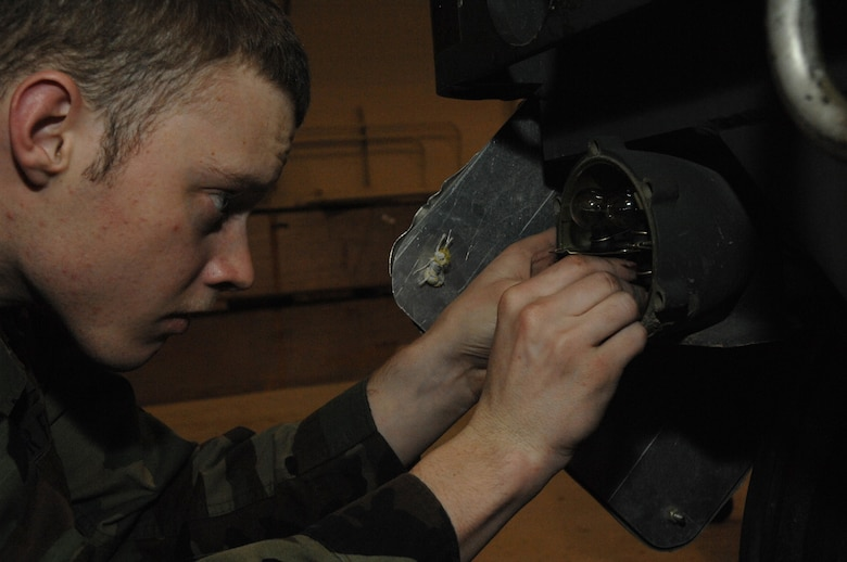 EIELSON AIR FORCE BASE, Alaska --  Airman First Class Daryl Mitchell, 354th Maintenance Squadron, 354th Fighter Wing, inspects a brake light assembly during a 365 inspection on an MHU-141/M Munitions Handling Trailer here on 13 December. The inspection is a yearly operational and maintenance check on the trailer which can be configured to carry different munition types.  (U.S. Air Force Photo by Staff Sgt Joshua Strang)