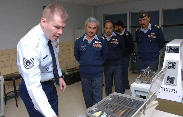 Members of the Pakistan Air Force listen as Tech. Sgt. Eric Miller of the 365th Training Squadron explains how instructors teach Airmen to use the Daniels Kit, a tool used to repair complex wiring systems on F-16s. Also pictured are, from left to right, Air Vice Marshall Muhammad Hassan, Air Commodore Khalid Chishti, Squadron Leader Muhammad Iftikhar and Col. Waseem Medhi. (U.S. Air Force photo/Mike Litteken)