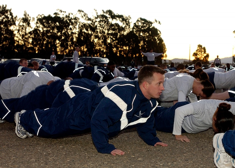 Staff Sgt. Jacob Beck, 30th Space Communications Squadron,  warms up before the 30th Space Wing's monthly Fit to Fight run December 7, 2006 here. The five-kilometer run takes place on the first Thursday of every month.  (U.S. Air Force photo by Airman 1st Class Stephanie Longoria)