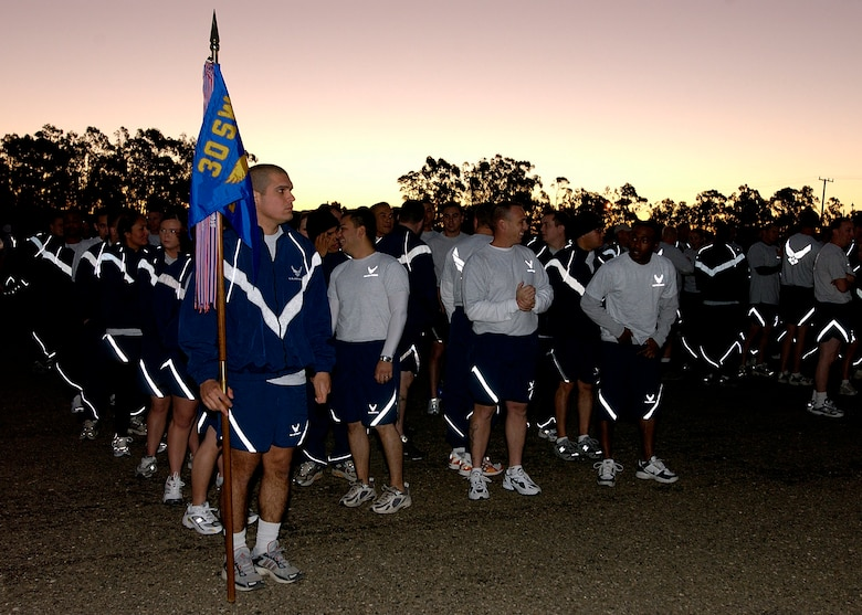 Members of the 30th Space Wing form up in preparation for the wing's monthly Fit to Fight run December 7, 2006 here. The five-kilometer run takes place on the first Thursday of every month.  (U.S. Air Force photo by Airman 1st Class Stephanie Longoria)