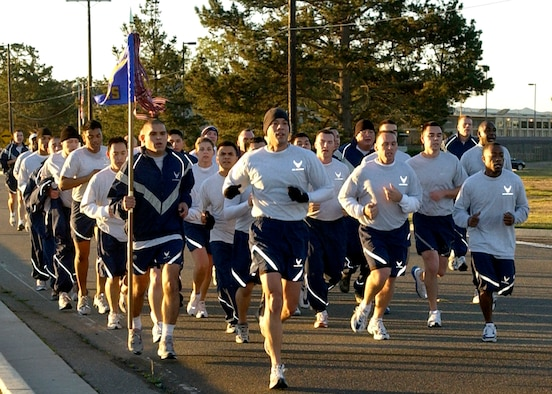 Members of the 30th Logistics Readiness Squadron run in formation during the 30th Space Wing's monthly Fit to Fight run December 7, 2006 here. The five-kilometer run takes place on the first Thursday of every month.  (U.S. Air Force photo by Airman 1st Class Stephanie Longoria)