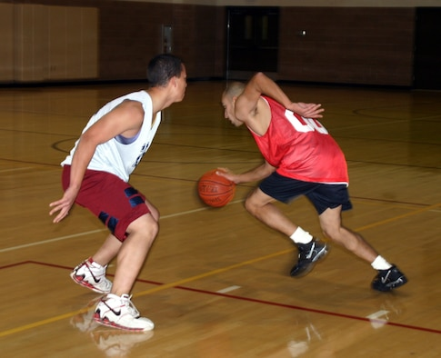 Milo Gardea from the Sheppard Fire Department moves to evade an opponent in an intramural basketball game between the 82nd Communications Squadron and the SFD Tuesday at the Levitow Fitness Center. (U.S. Air Force photo/Airman Jacob Corbin).