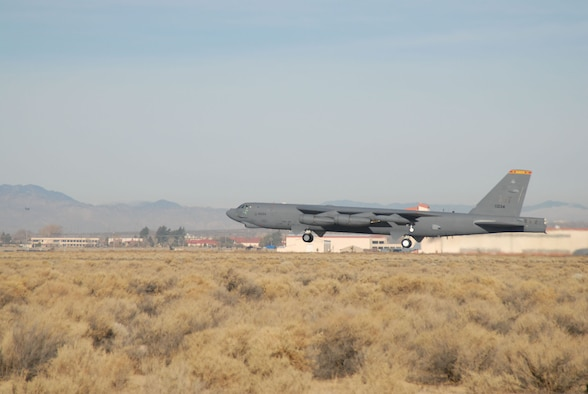 A B-52 Stratofortress takes off from Edwards Air Force Base, Calif., Dec. 15 during a flight-test mission using a blend of synthetic fuel and JP-8 in all eight engines.  This is the first time a B-52 has flown using a synfuel-blend as the only fuel on board.  In September, the Air Force successfully flew a B-52 with two-engines using the synfuel-blend while the others used standard fuel. The B-52 test flights at Edwards are the initial steps in the Air Force process to test and certify a synthetic blend of fuel for its aviation fleet. (U.S. Air Force photo/Tech. Sgt. Eric M. Grill)