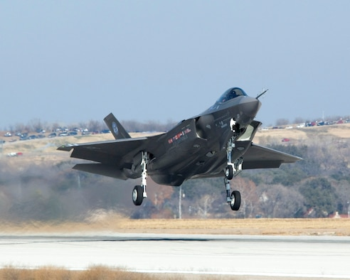 An F-35 Lightning II Joint Strike Fighter takes off at 12:44 p.m. CST at Lockheed Martin in Fort Worth, Texas Dec. 15 for an initial flight as part of system development testing. (Lockheed Martin photo/Tom Harvey)