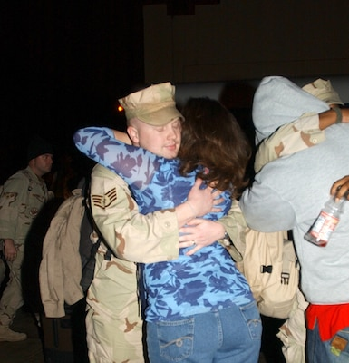 Staff Sgt. Michael Garrett, 12th Flying Training Wing Security Forces, greets his wife, Lauri, upon returning from a six-month deployment to Eskan Village, Kingdom of Saudi Arabia. (Photo by Staff Sgt. Beth Del Vecchio)