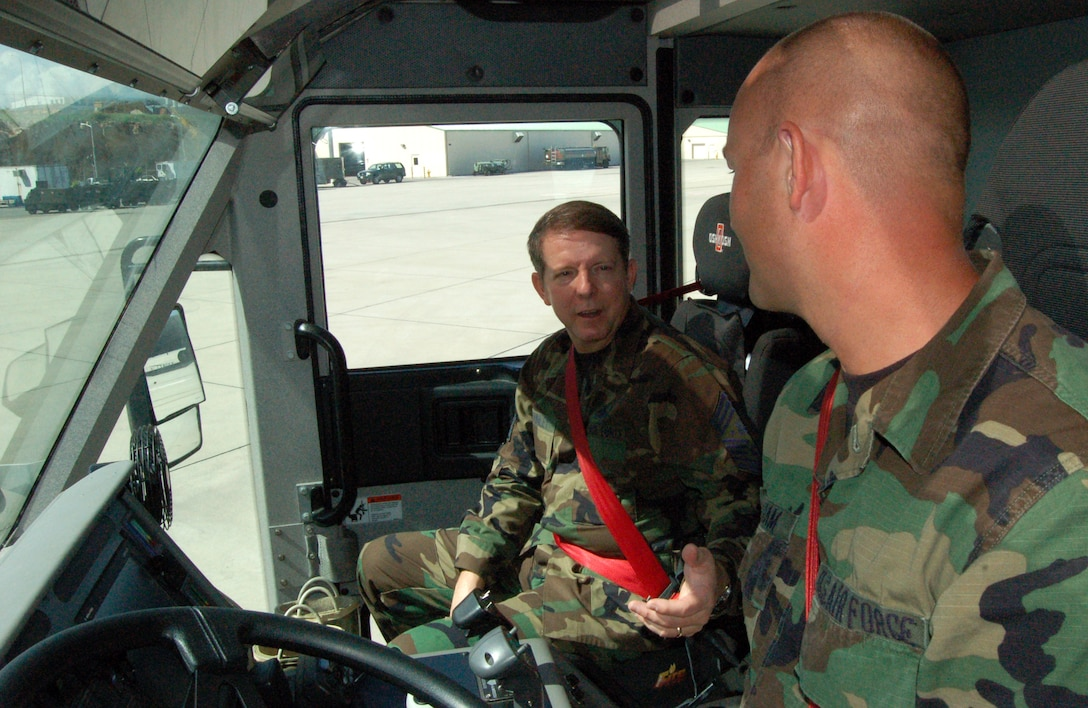 Chief Master Sgt. of the Air Force Rodney J. McKinley talks to firefighter Staff Sgt. Ron Wareham about his fire truck Dec. 14 at Forward Operating Location Curacao, Netherlands Antilles. The chief stopped at the base to receive a mission orientation, talk to Airmen about Air Force issues, and spread some holiday cheer. Sergeant Wareham is a guardsman deployed to Curacao from the 174th Fighter Wing at Syracuse, N.Y. (U.S. Air Force photo/Louis A. Arana-Barradas)