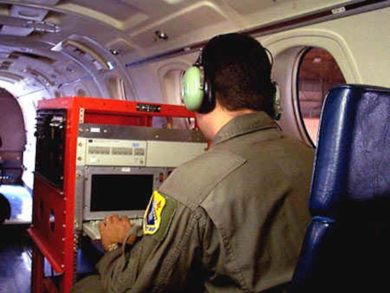 Navigation rack preflight check.  The C-12J is capable of carrying up to four fully powered, independent test racks with an operator for each rack.