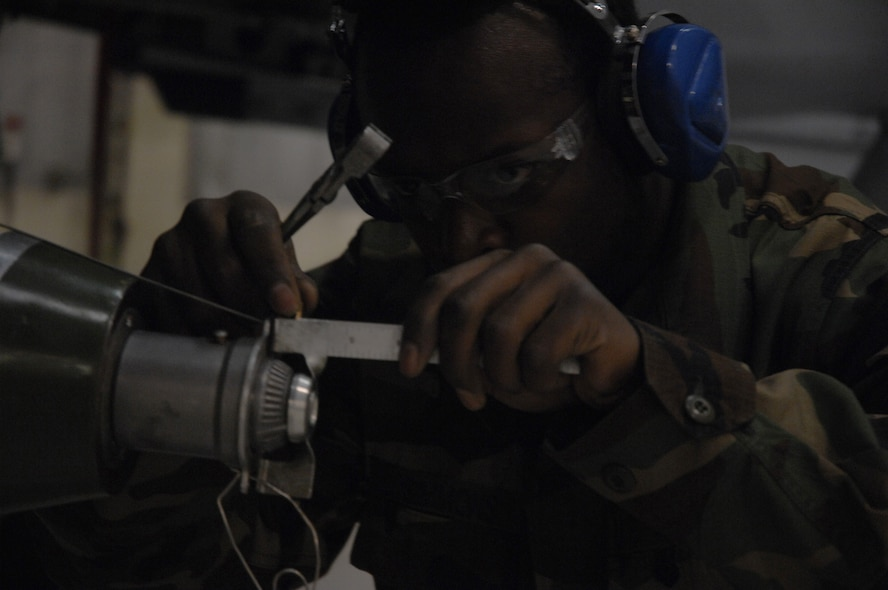 EIELSON AIR FORCE BASE, Alaska -- Senior Airman Vankeithin Simmons works on a MK-82 bomb during the Load Crew of the Quarter contest here on 15 December. The Airman represents the 355th Aircraft Maintenance Unit (AMU) and the quarterly contest pitts the 18th AMU versus the 355th AMU. Both teams loaded 2 MK-82 low drag bombs and one AIM-9 sidewinder missile to their respective aircraft. (U.S. Air Force Photo by Staff Sgt Joshua Strang)