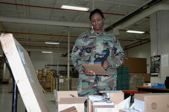YOUNGSTOWN AIR RESERVE STATION, Ohio — Air Force Reserve Senior Airman Aisha Graham, a logistics technician with the 910th Logistics Readiness Squadron, scans a shipment of incoming supply items at the base supply shipping/receiving warehouse here Dec. 19, 2006.  Airman Graham joined the 910th in December 2004 and is attending Akron University pursuing a Bachelor's Degree in Criminal Justice and Political Science.  U.S. Air Force photo/Master Sgt. Bryan Ripple.