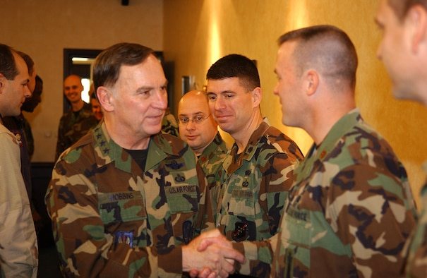 General Tom Hobbins, U.S. Air Forces in Europe commander, shakes hands with 39th Air Base Wing members after arriving here Dec. 20. General Hobbins and Chief Master Sgt. Gary Coleman, USAFE command chief, visited Team Incirlik to talk with Airmen, discuss future USAFE operations and wish every one here a happy holiday season. (U.S. Air Force photo by Staff Sgt. Chris Galindo)