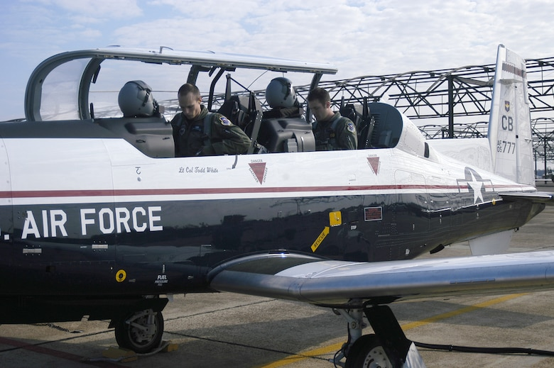 Specialized undergraduate pilot training student 2nd Lt. Rocky Harrisberger (left) and instructor pilot 1st Lt. Mike Glass prepare to fly the first T-6A Texan II student training sortie Dec. 15. Columbus Air Force Base is in the process of phasing of the aging T-37 Tweet for the newer, more efficient T-6. (USAF photo by 2nd Lt. Kristin Hollrith)