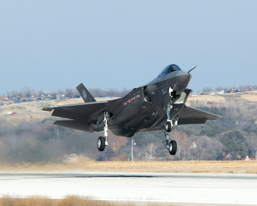 The F-35 Lightning II Joint Strike Fighter takes off for its initial flight Dec. 15 over Fort Worth, Texas. (Lockheed Martin photo/Tom Harvey)