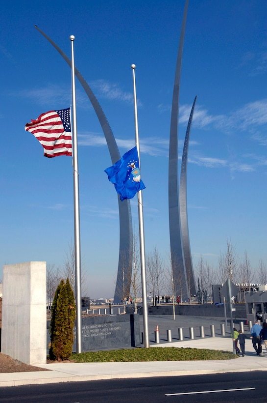The American flag and the U. S. Air Force flag fly at half staff in front of the Air Force Memorial in Arlington, Va. in honor of President Gerald R. Ford, who passed away Dec. 26 at age 93. During his tenure as president, Ford signed legislation permitting women to enter military academies Oct. 7, 1975. Women first entered the United States Air Force Academy on June 28, 1976. He will be laid to rest Jan. 2 on the grounds of the Gerald R. Ford Presidential Museum in Grand Rapids, Mich., the president's hometown. (U. S. Air Force photo/Tech Sgt. Cohen A. Young)