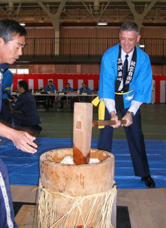 MISAWA AIR Base, Japan -- Brig. Gen. Sam Angelella, 35th Fighter Wing and installation commander, takes part in the annual mochitsuki ceremony Wednesday, Dec. 20. Mochitsuki, or pounding steamed rice, means making mochi (sweet rice cakes). Japanese schedule their mochitsuki events just before the New Year.  It is an event, allowing young and old to socialize and have fun in a community project.