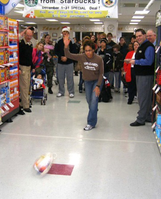 MISAWA AIR BASE, Japan --  A contestant participates in the 7th Annual Commissary Turkey Bowl Tuesday, Dec. 19. This year's contest was divided into two groups; kids and adults. The winners received a $25 shopping spree, while all participants received prizes.