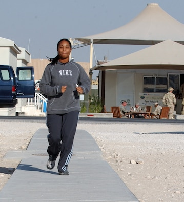 SOUTHWEST ASIA (AFPN) -- Tech. Sgt. Andrea Allen runs 3 miles during her deployment. She is with the 379th Air Expeditionary Wing's safety office at a forward-deployed location. The 3-mile run is a goal she made when she first arrived here. (U.S. Air Force photo by Staff Sgt. Joshua Strang)