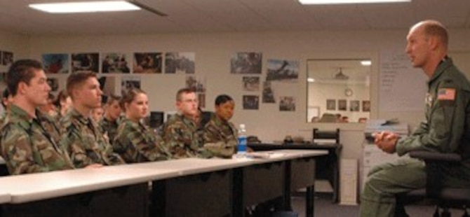 The newest members of the Travis Team listen as Col. Timothy Zadalis, 60th AMW acting commander, talks about the base at the First Term Airman Center Tuesday.