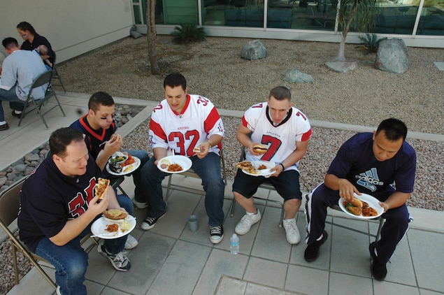 A group of sailors eat their food at the Branch Medical Clinic?s 3rd Annual Super Bowl Tailgate Party Feb. 2 at the BMC courtyard here.