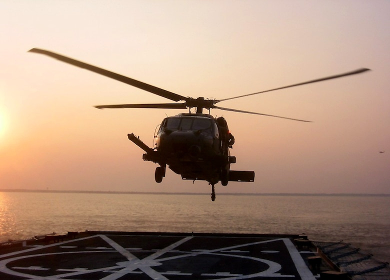 PENSACOLA BAY, Fla. - A 41st Rescue Squadron HH-60G Pave Hawk helicopter lands on the Baylander, a Navy vessel used for helicopter training, during ship boarding operations Jan. 25 and 26 at Pensacola Bay, Fla. The exercise is a mandatory training requirement for the 41st RQS, stationed at Moody Air Force Base, Ga., and improves its search and rescue capabilities. (Photo by Tech. Sgt. Mark Riensche)