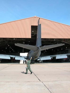 With air horn in one hand to alert others if necessary, a maintenance member of the 507th Air Refueling Wing offers a thumbs up, indicating this KC-135 is on the right path as it's being towed into the hangar for repairs. The Air Force also gave the 507th ARW a thumbs up recently, presenting the wing with an Air Force Meritorious Unit Award for superior performance.