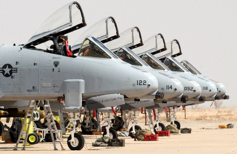 OPERATION IRAQI FREEDOM -- A-10 Thunderbolt IIs ares lined up on the flightline of Tallil Air Base in southern Iraq awaiting pilots.  The aircraft are part of the 442nd Fighter Wing from Whiteman Air Force Base, Mo., which was deployed to Talli and Kirkuk Air Bases in 2003.  (U.S. Air Force photo by Master Sgt. Terry L. Blevins)