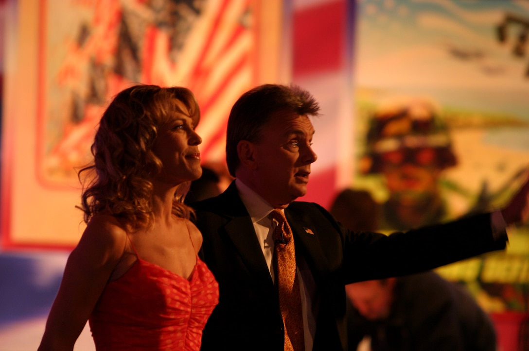 """Pat Sajak and Vanna White of """"Wheel of Fortune"""" address the studio audience during a taping of the popular game show at Sony Entertainment Studios in Los Angeles Feb. 8. The show featured 15 servicemembers as contestants when hosted """"Wheel Salutes the Armed Forces,"""" which is scheduled to air the week of April 3."""