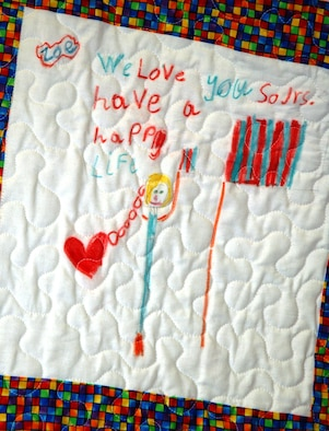 """One square in a """"Quilt of Valor"""" designed by first-grade children at Sangree Elementary School in Summerville, S.C.  Four quilts were presented to Chaplain (Maj.) John Painter, a reservist assigned to the 315th Airlift Wing at Charleston AFB, S.C.  Chaplain Painter accepted two quilts on behalf of his civilian employer the Ralph H. Johnson VA Medical Center and two quilts that will be delivered by the 315th Airlift Wing to a regional hospital in Germany. (Photo by Tech. Sgt. Mark Kleber, USAFR)"""