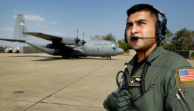 KORAT ROYAL AIR FORCE BASE, Thailand (AFPN) -- Airman 1st Class Victor Reynosa waits for an engine start-up on a C-130 Hercules before a Cope Tiger '06 mission here Feb. 7.  Airman Reynosa is one of 300 U.S. military members and 1,000 military members from Thailand and Singapore who are participating in the exercise, headquartered 110 miles northeast of Bangkok. Officials say Cope Tiger provides air-to-air, air-to-ground and large force employment training for crews in a multi-national environment while expanding the capabilities and readiness of U.S. and allied forces. Cope Tiger '06 is scheduled to end Feb. 18. Airman Reynosa is a C-130 loadmaster with the 36th Airlift Squadron at Yokota Air Base, Japan. (U.S. Air Force photo by Tech. Sgt. Keith Brown)
