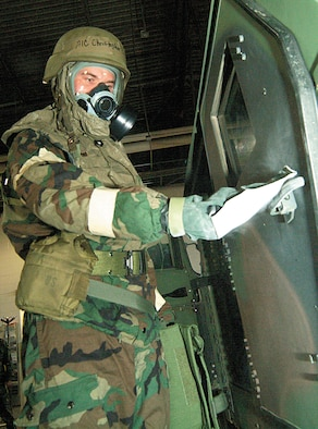 WHITEMAN AFB, Mo. -- Senior Airman Christopher Brockway, 442nd Logistics Readiness Squadron vehicle operations, decontaminates a vehicle door handle for a decontamination training exercise during the February 2006 Unit Training Assembly. The 442nd LRS is part of the 442nd Fighter Wing, an Air Force Reserve unit based at Whiteman Air Force Base, Mo. (Photo by Master Sgt. Bill Huntington)