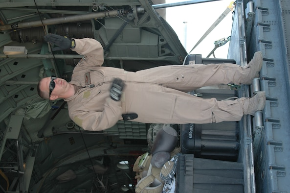 BALAD AB, IRAQ- Tech. Sgt. John Mangefrida,746th Expeditionary Airlift Squadron, C-130H Loadmaster signals fork lift operator directions at Balad Air Base. (Air Force photo by Master Sgt. Peter Borys) (Released)