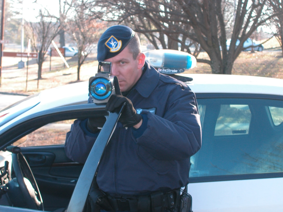 "DOBBINS AIR RESERVE BASE, Ga. -- Staff Sgt. Rick Berghult, 94th Security Forces Elite Gate Guard, aims in on passing vehicles.  He does not have a specific target.  He says he would be happy to ""shoot"" anyone that drives by because at least one person deserves it.  The new LIDAR system is the latest in speed detection at Dobbins Air Reserve Base."